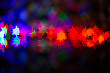 A festive kaleidoscope, a bright light and glare. Abstract composition of lights and figured bokeh. A good holiday background for Screens and sites.