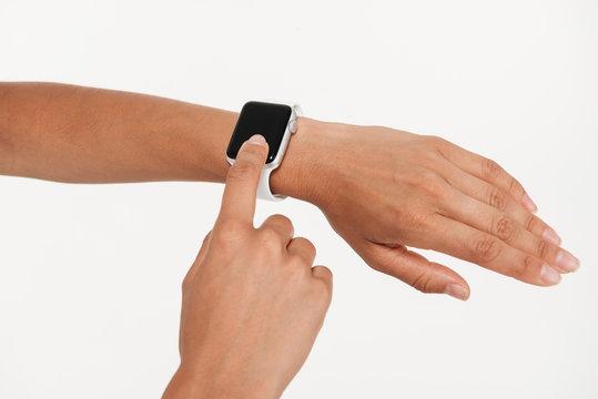 Close up portrait of female hands using wrist smart watch