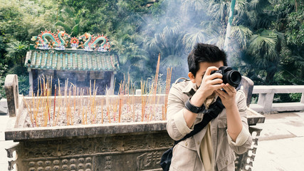 tourist taking photo in chinese temple, old film look filter effect effect