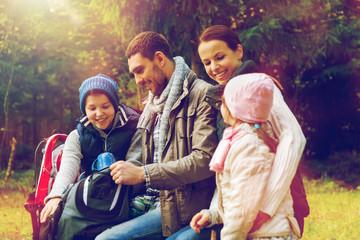 happy family drinking hot tea at camp