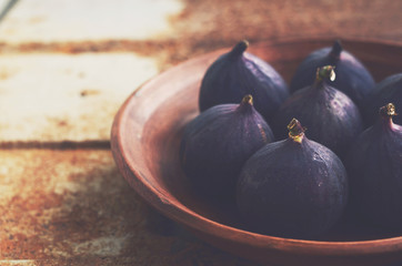 Purple figs on grunge metal background