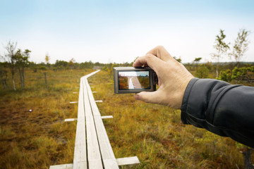 Person shoots a landscape with the camera