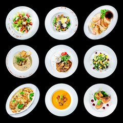 set of various plates of food isolated on black background with clipping path for Menu