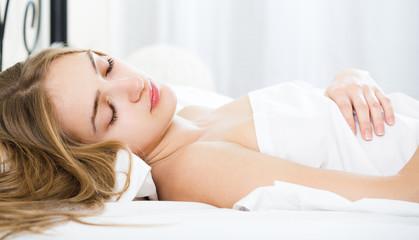 Portrait of girl sleeping in bed.