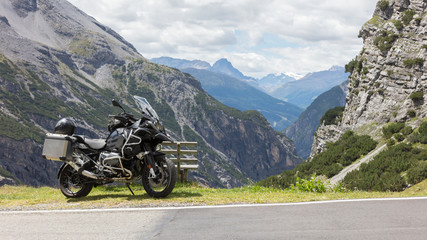 Unrecognisable motorcycle and driver in the Alps