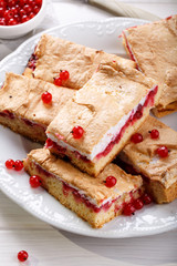 Red currant fruit pie bars with meringue on top.