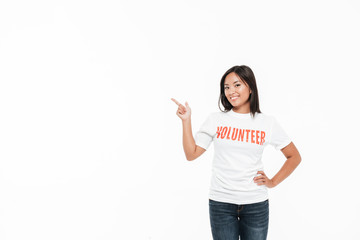 Portrait of a smiling joyful asian woman in volunteer t-shirt