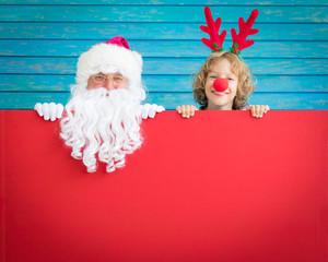 Santa Claus and reindeer child