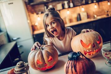 Girl with Halloween pumpkins Wall mural