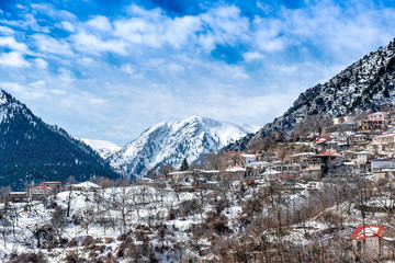 Snowy landscape. Winter with snow on a greek village at lake Plastira. Central Greece
