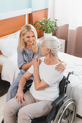 nurse and senior woman in wheelchair