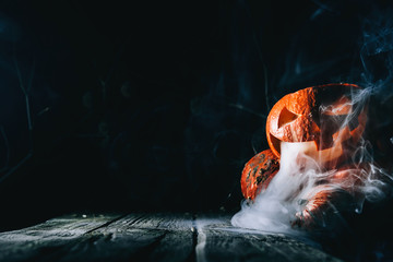 Pumpkin to celebrate Halloween on a wooden background