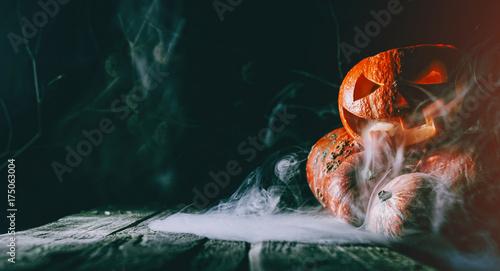 Pumpkin to celebrate Halloween on a wooden background