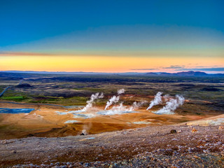 a lot of geysers in Iceland at sunset