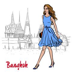 woman near Grand Palace and Wat Prakeaw
