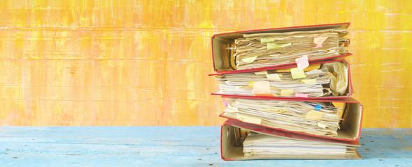 messy file folders,panoramic format, good copy space