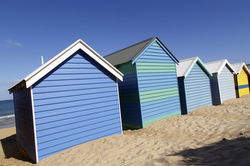 Dramatic angle of the iconic Brighton Beach Huts in Australia with beautiful blue skies