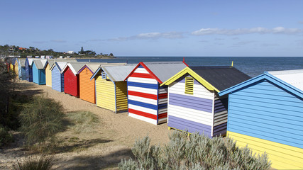 Row of iconic colourful beach huts at Brighton Beach in Melbourne