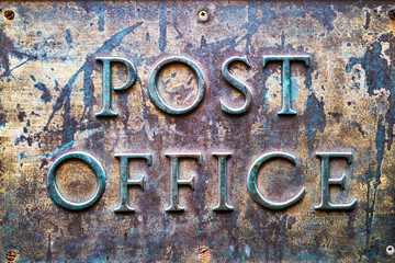Vintage old retro Post Office sign in metal closeup