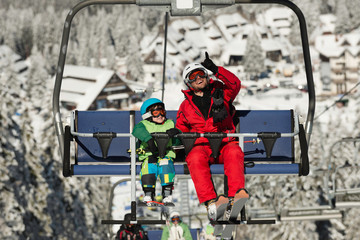 Father and son on ski lift