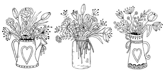 Three vases with floral bouquets.