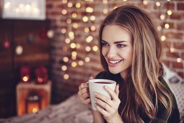 Attractive woman drinking hot tea