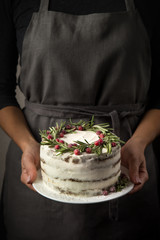 Woman holds festive christmas gingerbread cake
