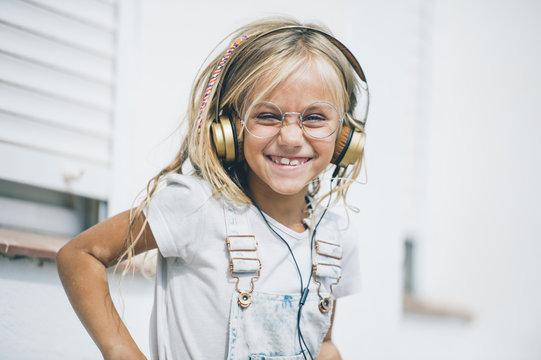Blond girl blue eyes with headphones