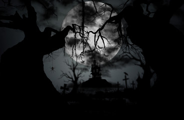 Halloween night background with moon, spider, castle, gravestone and old tree.