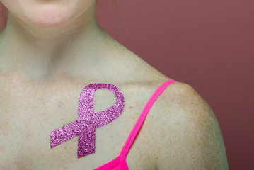 Closeup of a Woman Wearing Breast Cancer Awareness Sticker