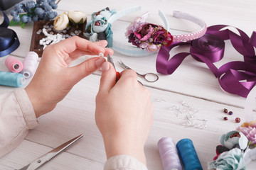 Master making handmade jewelry, woman pov