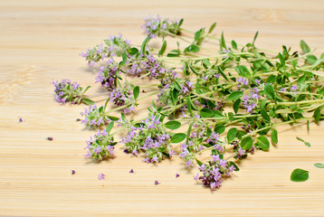 Bunch of thyme on a kitchen board