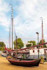 Ancient restored sailing boat in the Dutch harbor of Gouda