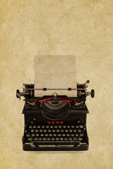 Vintage typewriter in front of a sepia background