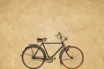 Vintage bicycle in front of a sepia background