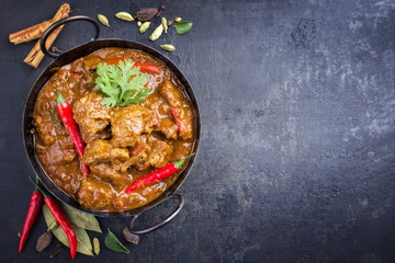 Traditional Indian curry lamb masala as close-up in a Korai with copy space right