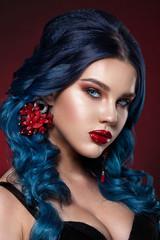 Beauty face of a girl with blue hair with a braid hair.