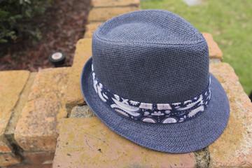 Blue Hat Fashion On A Brick Wall
