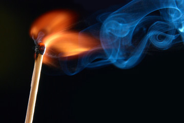 Match with smoke and fire