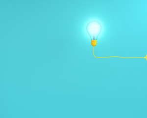 Hanging yellow light bulbs glowing on blue pastel background , Minimal concept idea