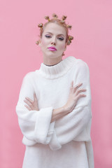 Portrait of a beautiful female model in front of the pink wall