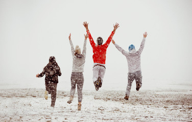 Happy friends friendship run jump first snow