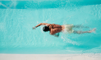 Freestyle swimming in pool