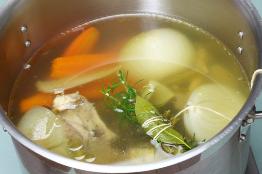 making chicken soup stock (bouillon) in a pot