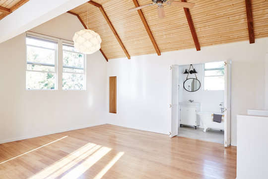 Empty bedroom with wood floors inside cottage