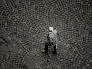 Overhead view of Muslim man with kufi walking on street