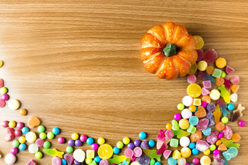 colorful halloween candy dessert party on wood ground