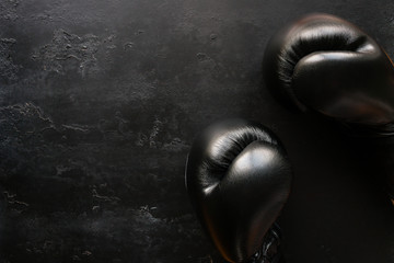 boxing gloves on a black background with space for text