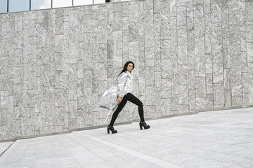 Stylish woman with a silver jacket