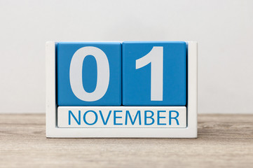 November 1st. Day 1 of month, wooden color calendar on light background. Autumn time